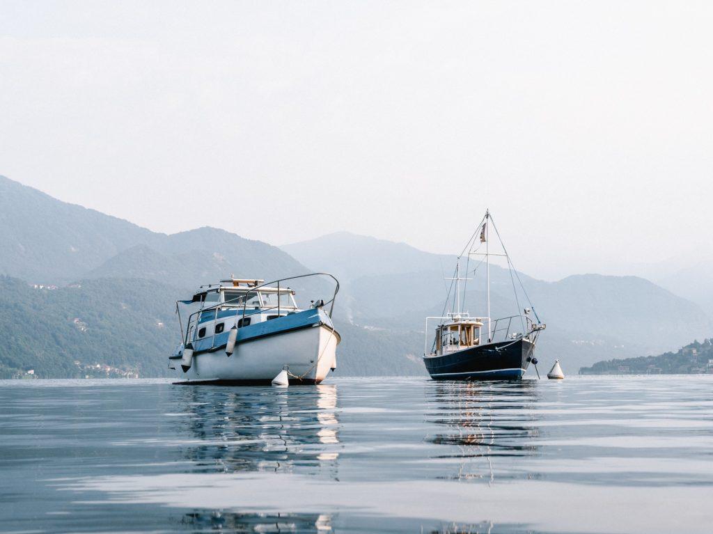 pass fishing boats on lake
